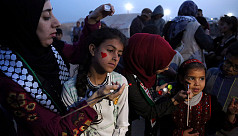 In Gaza, women protest among the burning...
