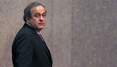 Platini says cleared by authorities,...