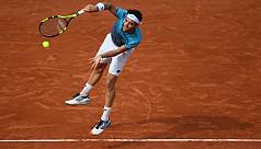 Cecchinato stuns former champion Djokovic...