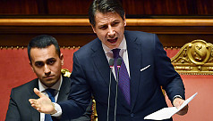 Italy PM takes aim at migrants, austerity...