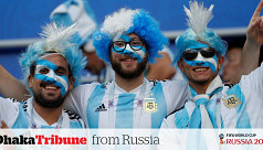 Hopeful Argentine fans chant away in...