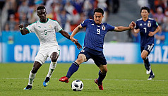 Senegal, Japan play out 2-2...