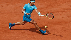 Nadal overcomes hiccup to march into...