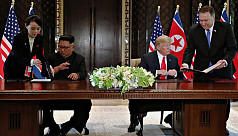 Trump, Kim sign agreement after historic...