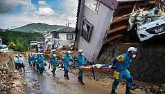 Japan rescuers go house to house as...