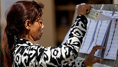 Cambodians vote in 'sham' election without...
