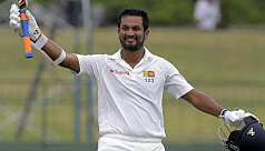 Defiant Karunaratne carries bat for...