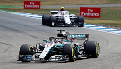 Hamilton retakes lead with victory in...