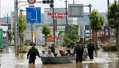 Rain kills at least 69 in Japan, strands...