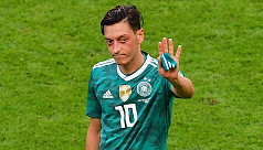 Ozil quits German national side citing...