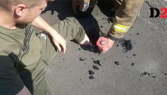 Man gets leg stuck in molten road