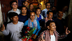 Cambodia frees 14 opposition...