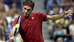 Federer, Djokovic thru as storm rages...