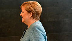 Merkel condemns 'hunt' against foreigners...