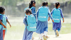 Rohingya children learning Bangla in...