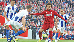 Salah sends Liverpool top as City held...