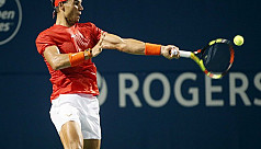 Nadal routs Paire to reach third round...