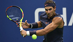 Nadal eases past Pospisil to reach US...