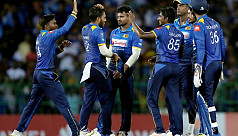 Sri Lanka's cricket team train with...