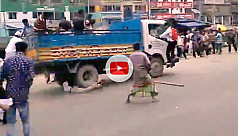 Pick-up truck runs over protesting student...