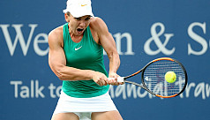 Halep beats Sabalenka to reach third...