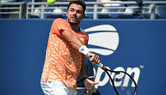 Wawrinka tames heat and young Frenchman...