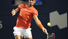 Nadal sets up showdown with...