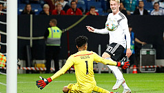 Schulz strikes on debut to grab Germany...