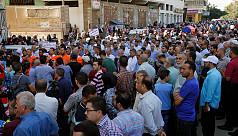 Thousands protest UN job cuts in...