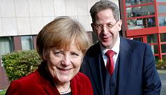 German coalition avoids split with solution...