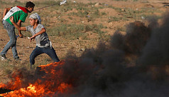Palestinians say Israeli troops fire...