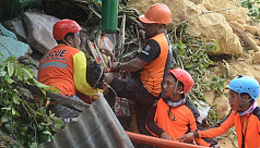 Landslide kills 12 in the Philippines,...
