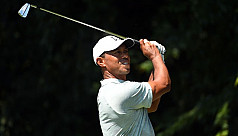 Woods maintains share of the lead at...