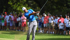 Woods takes three-shot lead at Tour...