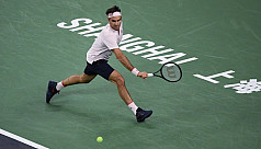 Federer makes shaky start to Shanghai...