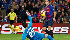 Barca thump Real as Suarez sticks knife...