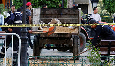 Woman blows herself up in central Tunis;...