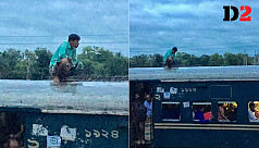 Man hops on train roof, urinates into...