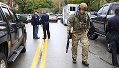 Gunman kills at least 8, injures 12...