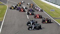 Hamilton romps to Japan win to close...