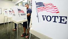 Americans start voting in midterm verdict...