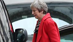 UK's May under assault over EU exit...