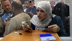 Qatar pays Gaza salaries to ease...