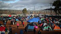 Trump says asylum seekers to wait in...