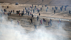 US fires tear gas into Mexico to repel...