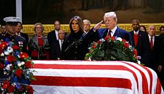 Trump pays respects as president Bush...