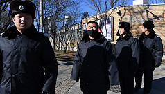 China probes two Canadians on suspected...
