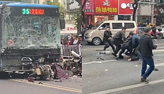 Eight killed in China as hijacked bus crashes into pedestrians