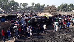 Truck flips over, kills 13 workers in...