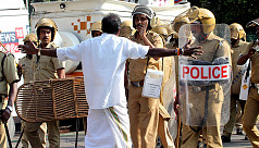 Indian police fire tear gas at protesters...
